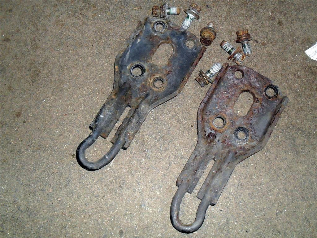 Towing and tie-down hooks
